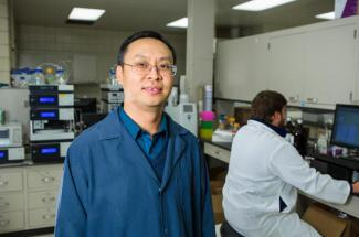 Photo of Jian Shi, assistant professor in the UK Department of Biosystems and Agricultural Engineering, in his lab.