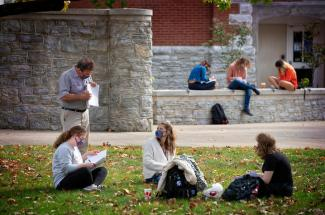 Photo of UK students in an outdoor class on campus in early November.