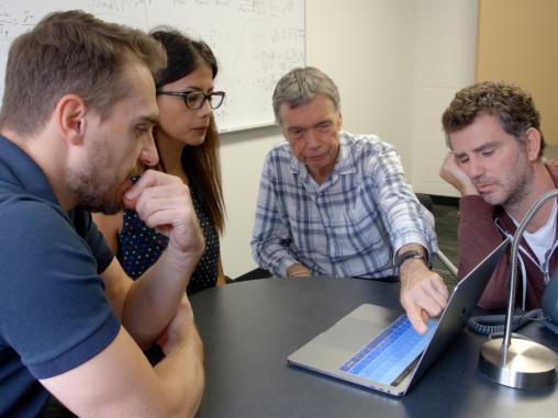 Gary Ferland with students around laptop