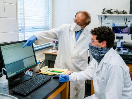 """Picture of UK engineering professor Dibakar Bhattacharyya, or """"DB,"""" directing research in his lab."""