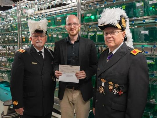 Oliver Voecking presented with check from the Knights Templar Eye Foundation