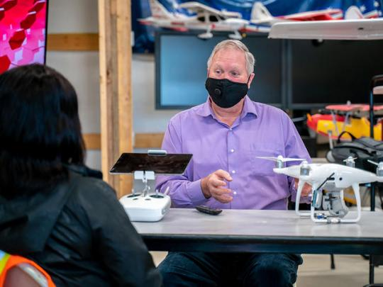 Photo of Bart Massey, Executive Director of the USA Drone Port talking to Community Health Worker Carole Frazier (foreground) about visual observer training for the Jericho Project to deliver PPE to rural Kentuckians.
